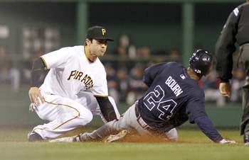 PITTSBURGH, PA - OCTOBER 01:  Chase d'Arnaud #3 of the Pittsburgh Pirates tags out Michael Bourn #24 of the Atlanta Braves during the game on October 1, 2012 at PNC Park in Pittsburgh, Pennsylvania.  The Pirates defeated Braves 2-1.  (Photo by Justin K. A