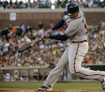 SAN FRANCISCO, CA - AUGUST 26:  Brian McCann #16 of the Atlanta Braves hits an RBI single driving in Jason Heyward #22 (not pictured) in the first inning against the San Francisco Giants at AT&T Park on August 26, 2012 in San Francisco, California.  (Phot