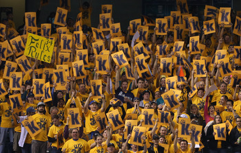SEATTLE, WA - SEPTEMBER 19:  Fans in the King's Court section cheer for starting pitcher Felix Hernandez of the Seattle Mariners during the game against the Baltimore Orioles at Safeco Field on September 19, 2012 in Seattle, Washington.  (Photo by Otto Gr