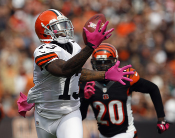 CLEVELAND, OH - OCTOBER 14:  Wide receiver Josh Gordon #13 of the Cleveland Browns catches a touchdown pass in front of safety Reggie Nelson of the Cincinnati Bengals at Cleveland Browns Stadium on October 14, 2012 in Cleveland, Ohio.  (Photo by Matt Sull