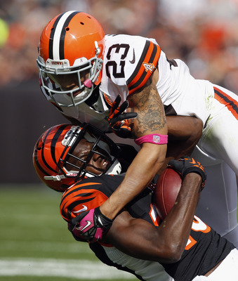 CLEVELAND, OH - OCTOBER 14:  Wide receiver A.J. Green #18 of the Cincinnati Bengals is tackled by defensive back Joe Haden #23 of the Cleveland Browns at Cleveland Browns Stadium on October 14, 2012 in Cleveland, Ohio.  (Photo by Matt Sullivan/Getty Image
