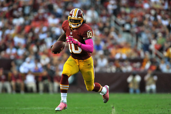 Robert Griffin III scrambles for a game-clinching touchdown during the fourth quarter against the Minnesota Vikings