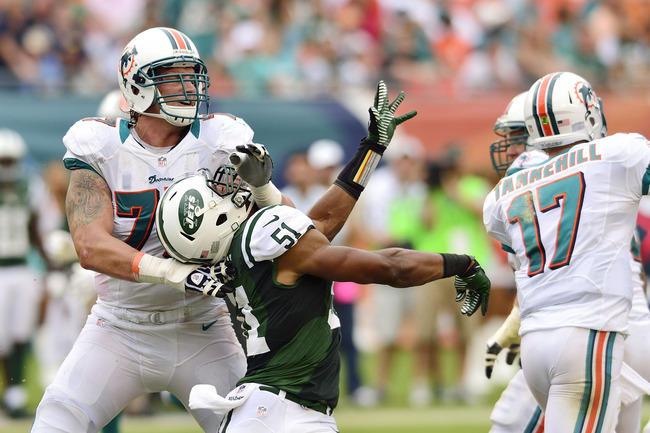 Sept 23, 2012;  Miami, FL, USA; Miami Dolphins tackle Jake Long (77) blocks New York Jets linebacker Aaron Maybin (51) during the second half at Sun Life Stadium. THe Jets won 23-20 in overtime. Mandatory Credit: Steve Mitchell-US PRESSWIRE