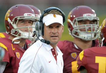 Sep 22, 2012; Anaheim, CA, USA; Southern California Trojans coach Lane Kiffin (center), quarterback Matt Barkley (left) and center Abe Markowitz (50) react during the game against the California Golden Bears at the Los Angeles Memorial Coliseum. USC defea