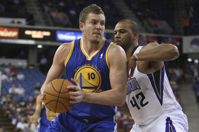 October 17, 2012; Sacramento, CA, USA; Golden State Warriors power forward David Lee (10) controls the ball against Sacramento Kings forward Chuck Hayes (42) during the first quarter at Sleep Train Arena. Mandatory Credit: Kelley L Cox-US PRESSWIRE
