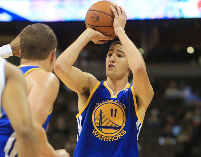 October 15, 2012; Denver, CO, USA; Golden State Warriors guard Klay Thompson (11) shoots the ball during the second half against the Denver Nuggets  at the Pepsi Center.  The Nuggets won 104-98.  Mandatory Credit: Chris Humphreys-US PRESSWIRE