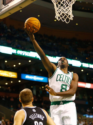 BOSTON, MA - OCTOBER 16: Jeff Green #8 of the Boston Celtics drives to the basket for a layup in front of Mirza Teletovic #33 of the Brookyln Nets during the preseason game on October 16, 2012 at TD Garden in Boston, Massachusetts. NOTE TO USER: User expr