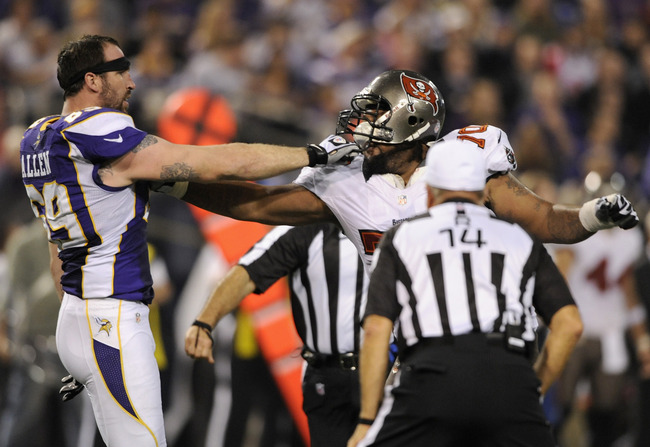 MINNEAPOLIS, MN - OCTOBER 25: Jared Allen #69 of the Minnesota Vikings holds back Donald Penn #70 of the Tampa Bay Buccaneers as referee Ron Winter #14 looks on during the third quarter of the game on October 25, 2012 at Mall of America Field at the Huber