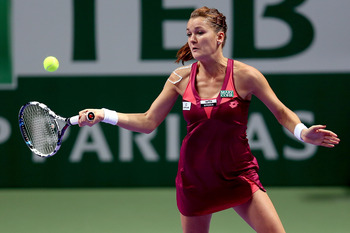 ISTANBUL, TURKEY - OCTOBER 24:  Agnieszka Radwanska of Poland returns a shot to Maria Sharapova of Russia in round robin play during the TEB BNP Paribas WTA Championships at the Sinan Erdem Dome October 24, 2012 in Istanbul, Turkey.  (Photo by Matthew Sto