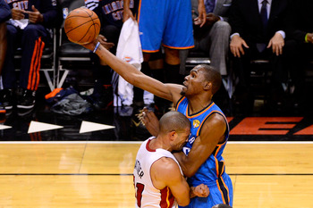 Shane Battier attempts to draw a charge from Kevin Durant.