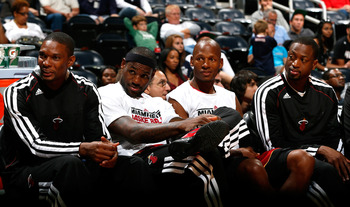The Miami Heat's superstars look on.