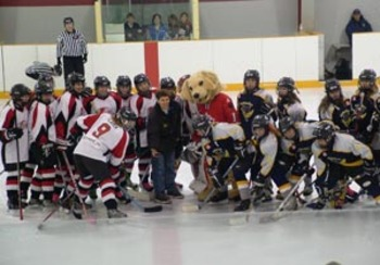 Phillips holds ceremonial faceoff Image from http://www.frontenacnews.ca/2007/march_15/girls_hockey.html