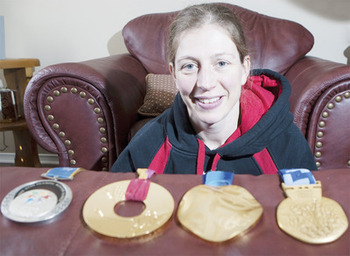With her four Winter Games medals (Courtesy of InsideHalton.com)