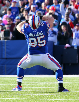 Kyle Williams celebrates a sack