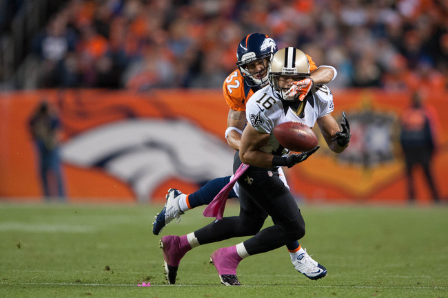 DENVER, CO - OCTOBER 28:  Defensive back Tony Carter #32 of the Denver Broncos breaks up a pass intended for wide receiver Lance Moore #16 of the New Orleans Saints during a game at Sports Authority Field Field at Mile High on October 28, 2012 in Denver,