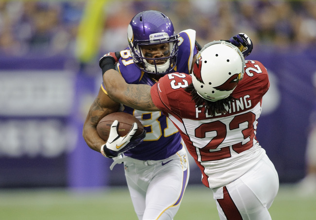 MINNEAPOLIS, MN - OCTOBER 21: Jamell Fleming #23 of the Arizona Cardinals tackles Jerome Simpson #81 of the Minnesota Vikings during the game on October 21, 2012 at Mall of America Field at the Hubert H. Humphrey Metrodome in Minneapolis, Minnesota. (Phot