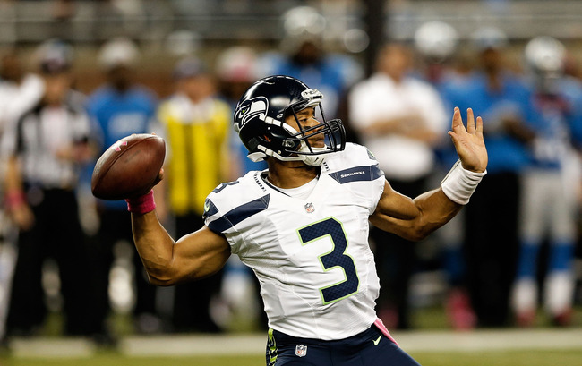 DETROIT, MI - OCTOBER 28:  Russell Wilson #3 of the Seattle Seahwaks drops back to pass during the fourth quarter of the game against the Detroit Lions at Ford Field on October 28, 2012 in Detroit, Michigan. The Lions defeated the Seahwaks 28-24.  (Photo 