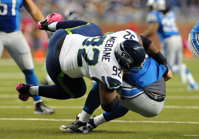 DETROIT, MI - OCTOBER 28:  Defensive tackle Brandon Mebane #92 of the Seattle Seahawks sacks quarterback Matthew Stafford #9 of the  Detroit Lions October 28, 2012 at Ford Field in Detroit, Michigan.  (Photo by Al Messerschmidt/Getty Images)