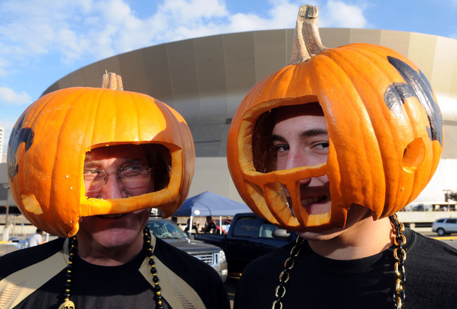 October 31, 2010; New Orleans, LA, USA; New Orleans Saints fans Tommy Loehn and his son T.J. Loehn in costume for Halloween outside the Louisiana Superdome before the Saints play the Pittsburgh Steelers. Mandatory Credit: Chuck Cook - US PRESSWIRE