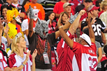 Oct 31, 2010; Glendale, AZ, USA;  Arizona Cardinals fan dressed in costume for Halloween reacts to a Cardinals touchdown in the 3rd quarter of a game against the Tampa Bay Buccaneers at University of Phoenix Stadium.  The Buccaneers won the game 38-35.  M