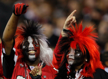 ATLANTA, GA - JANUARY 01:  Fans of the Atlanta Falcons cheer against the Tampa Bay Buccaneers at Georgia Dome on January 1, 2012 in Atlanta, Georgia.  (Photo by Kevin C. Cox/Getty Images)