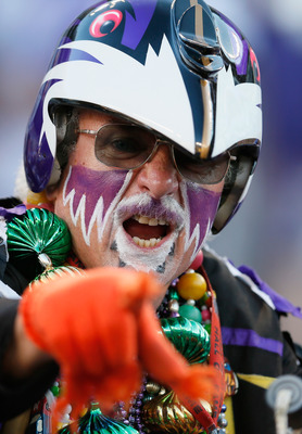 BALTIMORE, MD - SEPTEMBER 10:  A Baltimore Ravens fan watches the team warm up before the start of the Ravens game against the Cincinnati Bengals at M&T Bank Stadium on September 10, 2012 in Baltimore, Maryland.  (Photo by Rob Carr/Getty Images)
