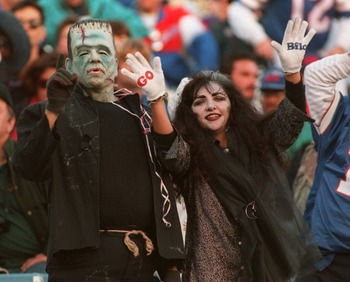 30 Oct 1994: TWO BUFFALO BILLS FANS ARE IN THE HALLOWEEN SPIRIT DURING THE CHIEFS VS BILLS GAME AT RICH STADIUM IN ORCHARD PARK, NY. THE BILLS BEAT THE CHIEFS 44-10.