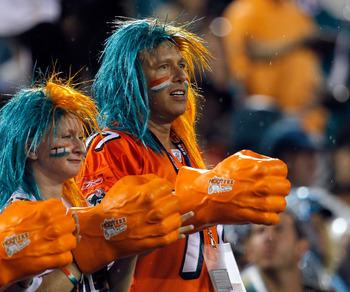 JACKSONVILLE, FL - AUGUST 21:  Miami Dolphins fans cheer during the preseason game against the Jacksonville Jaguars at EverBank Field on August 21, 2010 in Jacksonville, Florida.  (Photo by Sam Greenwood/Getty Images)
