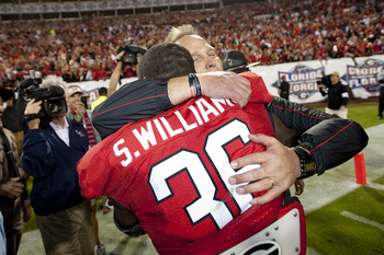 Oct 27, 2012; Jacksonville, FL, USA; Georgia Bulldogs head coach Mark Richt celebrates defeating the Florida Gators 17-9 with Georgia Bulldogs safety Shawn Williams (36) at EverBank Field. Mandatory Credit: Kevin Liles-US PRESSWIRE
