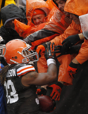 Oct 28, 2012; Cleveland, OH, USA; Cleveland Browns running back Trent Richardson (33) celebrates with fans after a touchdown run against the San Diego Chargers during the first quarter at Cleveland Browns Stadium. Mandatory Credit: Ron Schwane-US PRESSWIR