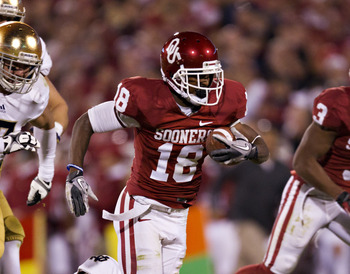 NORMAN, OK - OCTOBER 27:   Jalen Saunders #18 of the Oklahoma Sooners is tackled after catching a pass against the Notre Dame Fighting Irish at Gaylord Family Oklahoma Memorial Stadium on October 27, 2012 in Norman, Oklahoma.  The Fighting Irish defeated 
