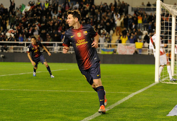 MADRID, SPAIN - OCTOBER 27:  Lionel Messi of Barcelona celebrates after scoreing his side's 5th goal during the La Liga match between Rayo Vallecano and Barcelona at Estadio Teresa Rivero on October 27, 2012 in Madrid, Spain.  (Photo by Denis Doyle/Getty