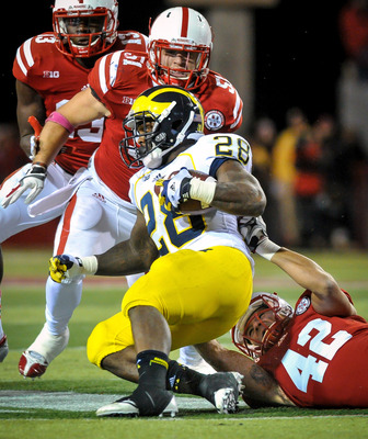 Sean Fisher (42) had two tackles-for-loss against Michigan.