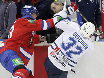 Zdeno Chara of Lev Praha checking Alex Ovechkin in a recent game. Reuters/David Cerny
