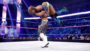 Natalya slams Layla (Photo Credit: WWE.com)