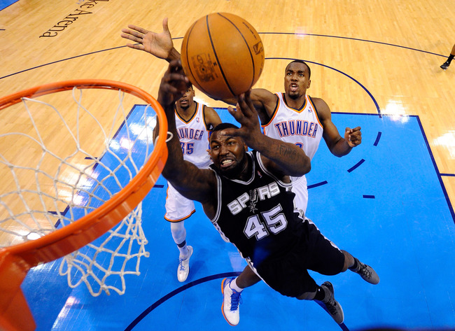OKLAHOMA CITY, OK - JUNE 02:  Serge Ibaka #9 of the Oklahoma City Thunder blocks the attempted layup by DeJuan Blair #45 of the San Antonio Spurs in the second half in Game Four of the Western Conference Finals of the 2012 NBA Playoffs at Chesapeake Energ