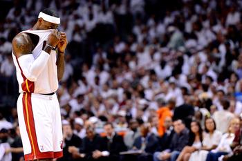 MIAMI, FL - JUNE 21:  LeBron James #6 of the Miami Heat wipes his face with his jersey against the Oklahoma City Thunder in Game Five of the 2012 NBA Finals on June 21, 2012 at American Airlines Arena in Miami, Florida. NOTE TO USER: User expressly acknow
