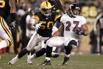 PITTSBURGH, PA - NOVEMBER 06:  Ray Rice #27 of the Baltimore Ravens runs with the ball while evading a tackle by Larry Foote #50 of the Pittsburgh Steelers during the game on November 6, 2011 at Heinz Field in Pittsburgh, Pennsylvania.  (Photo by Jared Wi