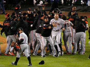 DETROIT, MI - OCTOBER 28:  Hunter Pence #8 of the San Francisco Giants celebrates with his teammates after they defeated the Detroit Tigers in the tenth inning to win Game Four of the Major League Baseball World Series at Comerica Park on October 28, 2012