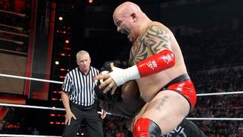 Tensai takes out Kofi's former tag partner, R-Truth (Photo Credit: WWE.com)
