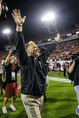 Oct 27, 2012; Jacksonville, FL, USA; Georgia Bulldogs head coach Mark Richt celebrates after the game against the Florida Gators at EverBank Field. The Bulldogs won 17-9.  Mandatory Credit: Daniel Shirey-US PRESSWIRE