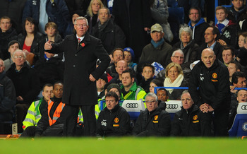 Sir Alex Ferguson marshals his players from the touchline at Stamford Bridge