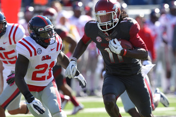 Oct 27, 2012; Little Rock, AR, USA; Arkansas Razorbacks wide receiver Cobi Hamilton (11) runs after a catch as Ole Miss Rebels defensive back Senquez Golson (21) defends at War Memorial Stadium. Mandatory Credit: Nelson Chenault-US PRESSWIRE