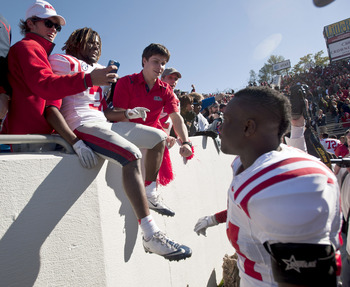 Oct 27, 2012; Little Rock, AR, USA; Ole Miss Rebels running back Jef Scott (3) poses for a photo with fans as linebacker Keith Lewis (24) looks on following a game against the Arkansas Razorbacks at War Memorial Stadium. Ole Miss defeated Arkansas 30-27.