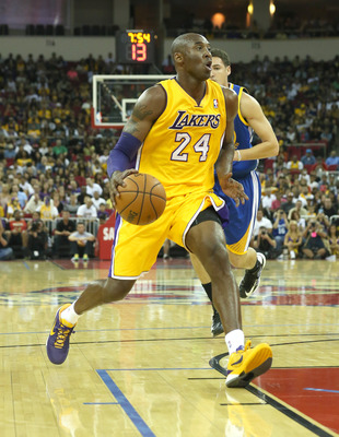 Kobe Bryant will isolate a lot less with Dwight Howard in the paint.