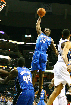 DeQuan Jones dunks during the Magic's preseason