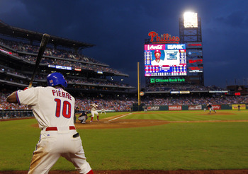 PHILADELPHIA, PA - SEPTEMBER 22: Juan Pierre #10 of the Philadelphia Phillies stands in the on deck circle as teammate Jimmy Rollins #11 bats in the eighth inning against the Atlanta Braves during a MLB baseball game on September 22, 2012 at Citizens Bank