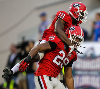 Georgia CB Sanders Commings (19) and LB Jarvis Jones (29)