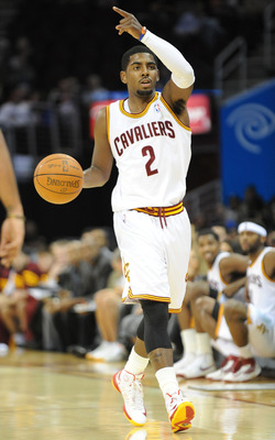 October 23, 2012; Cleveland, OH USA: Cleveland Cavaliers point guard Kyrie Irving (2) brings the ball up court during a preseason game against the Indiana Pacers at Quicken Loans Arena.  Mandatory Credit: Eric P. Mull-USPRESSWIRE