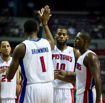 Oct 26, 2012; Auburn Hills, MI, USA; Detroit Pistons power forward Andre Drummond (1) high fives center Greg Monroe (10) during the third quarter against the Atlanta Hawks at The Palace. Detroit won 104-88. Mandatory Credit: Tim Fuller-US PRESSWIRE